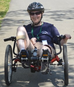 Pine Tree Camper enjoys a bike ride on an adaptive bicycle.
